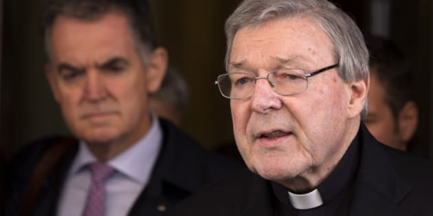 Australian cardinal George Pell reads a statement to reporters as he leaves the Quirinale hotel after meeting members of the Australian group of relatives and victims of priestly sex abuses, in Rome, Thursday, March 3, 2016. Pell, Pope Francis' top financial adviser, gave evidence for a fourth and final day to the Royal Commission into Institutional Responses to Child Sexual Abuse from a Rome hotel conference room a short distance from the Vatican. (AP Photo/Riccardo De Luca)