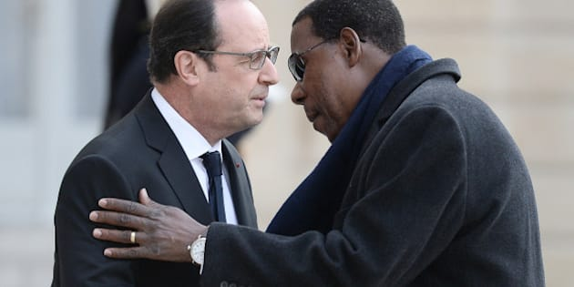 French President Francois Hollande welcomes Benin's President Thomas Boni Yayi upon his arrival at the Elysee Presidential Palace in Paris on February 8, 2016.   / AFP / STEPHANE DE SAKUTIN        (Photo credit should read STEPHANE DE SAKUTIN/AFP/Getty Images)