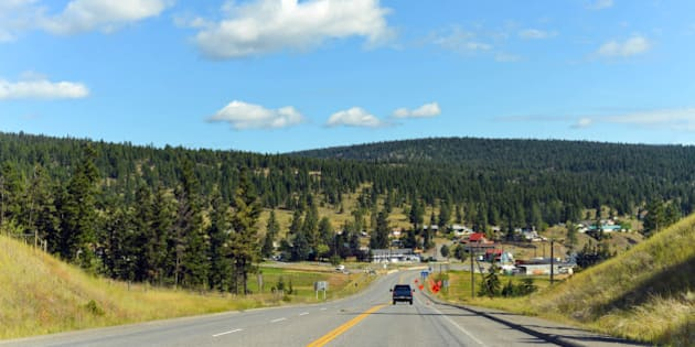 Summer day for a road trip through British Columbia, Canada. Highway 1 leading into a small town.