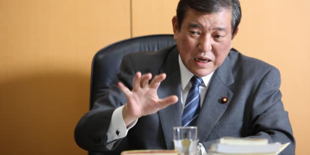 Shigeru Ishiba, Japan's minister in charge of overcoming population decline and vitalizing local economy, gestures as he speaks during an interview in Tokyo, Japan, on Wednesday, Jan. 21, 2015. The Abe government's chief for regional Japan looks into the future and sees enterprising communities that maintain their grip on state funding and flourish, and stragglers that are cut loose. Photographer: Tomohiro Ohsumi/Bloomberg via Getty Images