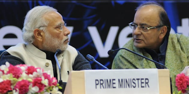 Indian Prime Minister Narendra Modi (L) and Finance Minister Arun Jaitley talk during an event to launch an initiative to bolster start-ups in New Delhi on January 16, 2016. Indian entrepreneurs will receive generous tax breaks and face dramatically reduced red tape when starting and closing a business, Prime Minister Narendra Modi said January 16, as he launched a pet initiative to bolster India's fast-growing startup scene. Speaking at a gathering of 2,000 entrepreneurs from India, Silicon Valley and elsewhere, Modi outlined a slew of measures under Start Up India including exempting startups from income tax for their first three years. AFP PHOTO / STR / AFP / STRDEL        (Photo credit should read STRDEL/AFP/Getty Images)