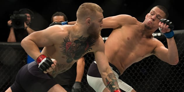 LAS VEGAS, NV - MARCH 5:   (L-R) Conor McGregor punches Nate Diaz in their welterweight bout during the UFC 196 in the MGM Grand Garden Arena on March 5, 2016 in Las Vegas, Nevada. (Photo by Brandon Magnus/Zuffa LLC/Zuffa LLC via Getty Images)