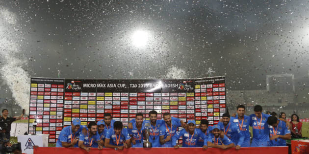 Indian players pose with the trophy after winning the Asia Cup Twenty20 international cricket final match against Bangladesh in Dhaka, Bangladesh, Sunday, March 6, 2016. India won the Asia Cup for the sixth time after beating host Bangladesh by eight wickets on Sunday.(AP Photo/ A.M. Ahad)