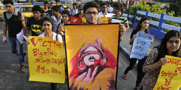 "Students participate in a walk protesting violence against women in Kolkata, India, Thursday, April 2, 2015. The protestors demanded immediate trial and verdict on rape cases, according to a press handout. Posters read ""annihilate rape from community,"" right, and ""down down rape culture,"" second right. (AP Photo/Bikas Das)"