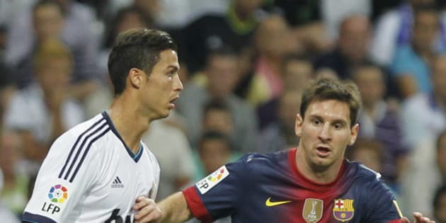 Real Madrid's Cristiano Ronaldo from Portugal, left, vies for the ball with FC Barcelona´s Lionel Messi from Argentina, right, during a Spanish Supercup second leg soccer match at the Santiago Bernabeu stadium in Madrid, Spain, Wednesday, Aug. 29, 2012. (AP Photo/Andres Kudacki)