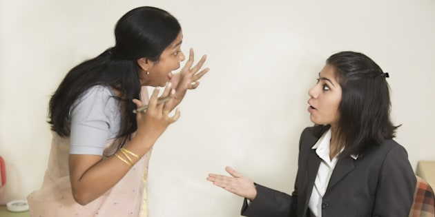 Two Indian Businesswoman fighting and screaming
