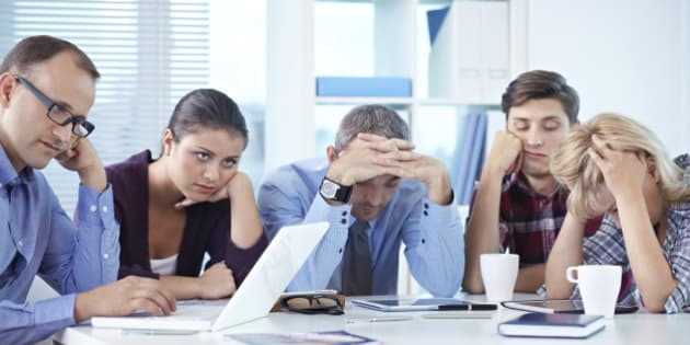 Business people tired of working