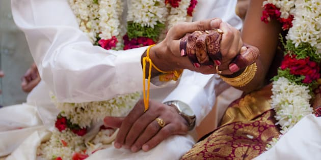 This moment is captured during the rituals process in a Indian Hindu wedding.