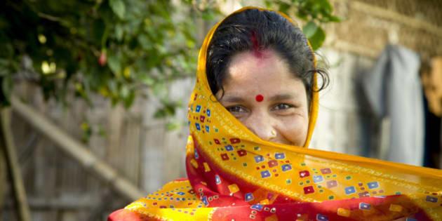 Woman wearing traditional Indian Sari for clothing. Dibrugarh, Arunachel Pradesh, North East India.