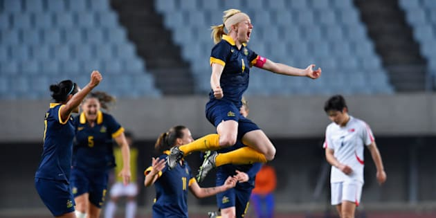 OSAKA, JAPAN - MARCH 07:  Captain Clare Polkinghorne of Australia celebrates her team's qualification for the Rio de Janeiro Olympic after her team's 2-1 win in the AFC Women's Olympic Final Qualification Round match between North Korea and Australia at Yanmar Stadium Nagai on March 7, 2016 in Osaka, Japan.  (Photo by Koki Nagahama/Getty Images)