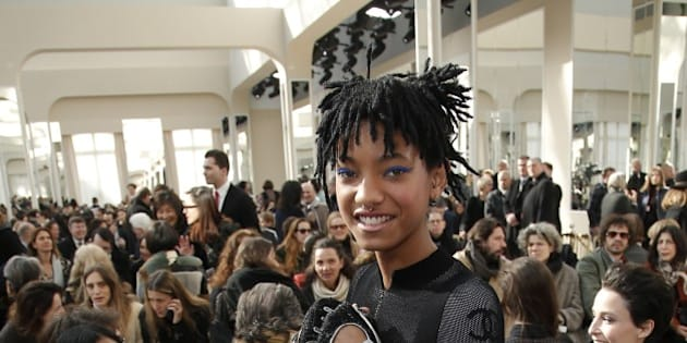 Willow Smith poses before Chanel's Fall-Winter 2016-2017 ready to wear fashion collection presented in Paris, Tuesday, March 8, 2016. Sitting at left is her mother Jada Pinkett Smith. (AP Photo/Thibault Camus)