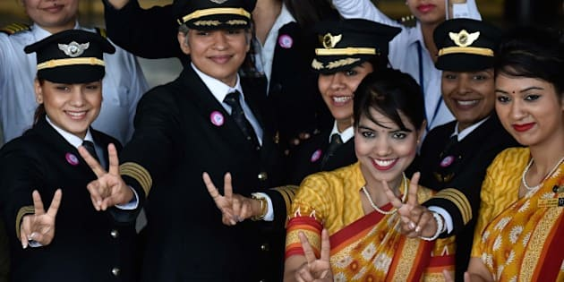 NEW DELHI, INDIA - MARCH 5: All Women Crew members of Air India's historic flight AI 173 (Del to SFO)  during a function to celebrate a 'Historic' New Delhi-San Francisco flight with all-women crew on board, on March 5, 2016 in New Delhi, India. Air India will operate the longest all-women crew flight from the national capital to San Francisco on March 6, to celebrate the International Women's Day (IWD). Celebrating the power of women, the flight AI 173 that'll take the non-stop Delhi-San Francisco route will set a record for being the world's longest all-women operated and supported flight. This first-of-its-kind flight will serve the passengers with an all-women staff, be it cabin crew, cockpit crew, and check-in staff, doctor or customer care staff. Not just that, the ground staff - from operator to technician, engineer, flight dispatcher and trimmer - will also all be women. (Photo by Vipin Kumar/Hindustan Times via Getty Images)
