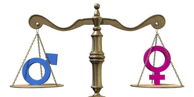 A gold justice scale with the two different gender symbols on either side balancing each other out on an isolated white background