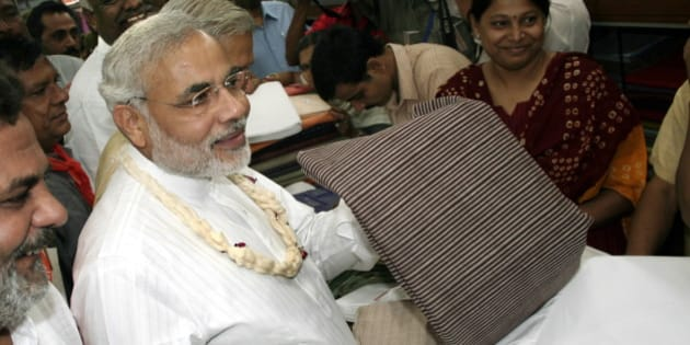 INDIA - NOVEMBER 04:  Narendra Modi, Chief Minister of Gujarat purchasing the Khadi in Ahmedabad Khadi Bhandar in Gujarat, India  (Photo by Shailesh Raval/The India Today Group/Getty Images)