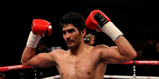 MANCHESTER, ENGLAND - OCTOBER 10:  Vijender Singh of India celebrates after defeating Sonny Whiting of Great Britain exchange blows during their International Middleweight contest at Manchester Arena on October 10, 2015 in Manchester, England.  (Photo by Ben Hoskins/Getty Images)