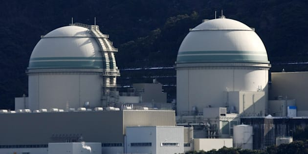 The No. 3, left, and No. 4 reactor buildings stand at Kansai Electric Power Co.'s Takahama nuclear power station in Takahama Town, Fukui Prefecture, Japan, on Monday, Feb. 20, 2012. Kansai Electric Power Co., which relied on nuclear operations to generate about 45 percent of the western region of Kansai's electricity before the quake, said the company is scheduled to shutdown the No. 3 reactor at the plant for regular maintenance tonight. Photographer: Tomohiro Ohsumi/Bloomberg via Getty Images