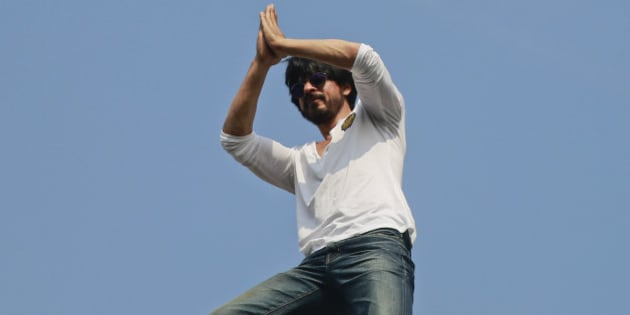 Bollywood superstar Shah Rukh Khan greets his fans who have gathered outside his home on his birthday in Mumbai, India, Monday, Nov. 2,2015. (AP Photo/Rafiq Maqbool)