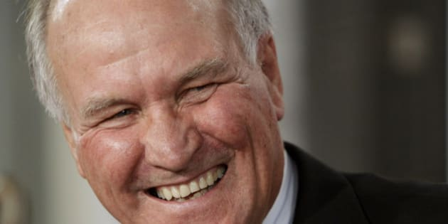 Independent member of parliament Tony Windsor laughs while at a National Press Club luncheon in Canberra, Australia, Wednesday, Aug. 25, 2010.  Three independent lawmakers who will likely decide which party governs Australia said Wednesday they plan to demand details of how much competing election promises would cost the nation over the next three years. (AP Photo/Rick Rycroft)