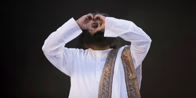 India's spiritual leader and founder of Art of Living Foundation Sri Sri Ravi Shankar looks to the crowd through a heart formed with his hands before leading a meditation with thousands of participants in Buenos Aires, Argentina, Sunday, Sept. 9, 2012. (AP Photo/Natacha Pisarenko)