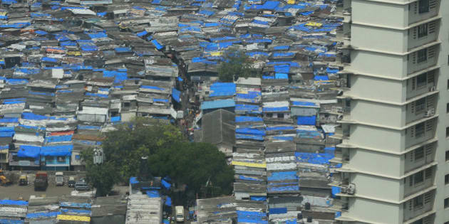 The Mumbai skyline where shanties occupy the same real estate next to swanky high rises in downtown Mumbai, India, Wednesday, July 15, 2015. (AP Photo/Rafiq Maqbool)