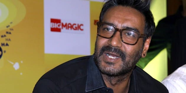 Indian Bollywood film actor, Ajay Devgn, as a brand ambassador for Hajmola Chatpata No.1, poses during a promotional event in Mumbai on February 26, 2015.    AFP PHOTO        (Photo credit should read STR/AFP/Getty Images)