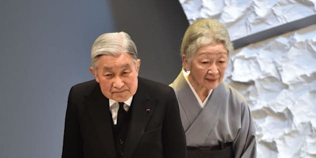 Japanese Emperor Akihito (L) and Empress Michiko (R) bow towards the audience as they leave the national memorial service for the victims of the March 11, 2011 earthquake and tsunami at the national memorial service in Tokyo on March 11, 2016.