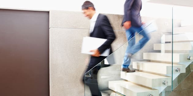 Business colleagues walking on flight of stairs