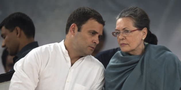 Congress party President Sonia Gandhi, right, listens to her son and party Vice President Rahul Gandhi during celebrations marking the birth anniversary of the first Indian Prime Minister Jawaharlal Nehru in New Delhi, India, Saturday, Nov. 14, 2015. The day is also marked as Children's Day in India. (AP Photo /Tsering Topgyal)