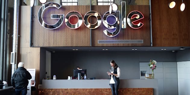 An employee checks her mobile device in the lobby of Google Canada's engineering headquarters in Waterloo, Ontario, Canada, on Friday, Jan. 22, 2016. The 185,000-square-foot facility currently houses over 350 employees from Google's Canadian development team. Photographer: Cole Burston/Bloomberg via Getty Images