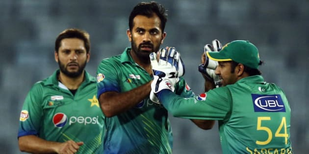 Pakistan's Wahab Riaz, center, celebrates with his teammates after the dismissal of Sri Lanka's captain Dinesh Chandimal during the Asia Cup Twenty20 international cricket match between them in Dhaka, Bangladesh, Friday, March 4, 2016. (AP Photo/A.M. Ahad)