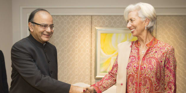 NEW DELHI, INDIA - MARCH 11: In this handout photo provided by the International Monetary Fund, International Monetary Fund Managing Director Christine Lagarde (R) and Indiaâs Finance Minister Arun Jaitley (L) shake hands after they signed a memo of understanding March 11, 2016 at the Taj Palace Hotel in New Delhi, India. (Photo by Stephen Jaffe/IMF via Getty Images)