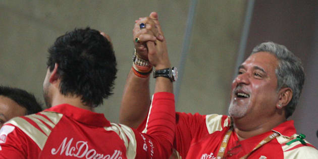NAVI MUMBAI, INDIA - APRIL 24: Royal Challengers Bangalore owner Vijay Mallya (R) with son Siddharth Mallya (L) during the 2010 DLF Indian Premier League T20 3rd Place match between Royal Challengers Bangalore v Deccan Chargers played at DY Patil Stadium on April 24, 2010 in Navi Mumbai, India.  (Photo by Chirag Wakaskar-IPL 2010/IPL via Getty Images)