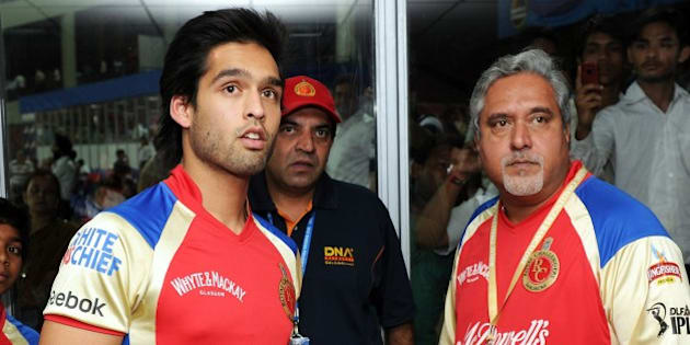 Sidhartha Mallya and his Dad, Vijay, closely watch a replay on TV at Feroz Shah Kotla Stadium, Delhi, April 26, 2011
