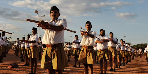 Members of Rashtriya Swayamsevak Sangh (RSS) - National Volunteers Organisation - take part in a physical drill during a public meeting in Bangalore on November 22, 2009. RSS Chief Mohan Rao Bhagwat arrived in the city to review the functioning of various state wings of the RSS and hold meetings with representatives of various social organisations.  Bhagwat addressed the public meeting attended by thousands of RSS volunteer and followers. AFP PHOTO/Dibyangshu SARKAR (Photo credit should read DIBYANGSHU SARKAR/AFP/Getty Images)