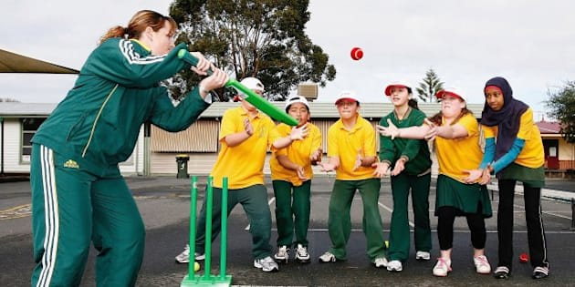 MELBOURNE, AUSTRALIA - AUGUST 01:  Australian cricketer Karen Rolton plays cricket with students during the 1Seven Media Launch at Footscray West Primary School August 01, 2006 in Melbourne Australia.  (Photo by Quinn Rooney/Getty Images)