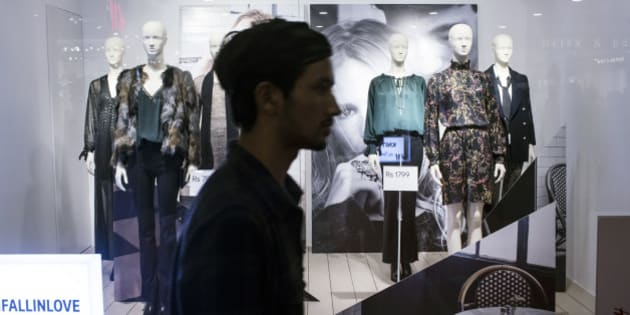 A pedestrian walks past a Hennes & Mauritz AB (H&M) window display at the Select Citywalk mall in the Saket area of New Delhi, India, on Friday, Oct. 2, 2015. The Swedish retailer, which has more than 3,600 outlets worldwide, opened its first store in India today. Photographer: Udit Kulshrestha/Bloomberg via Getty Images