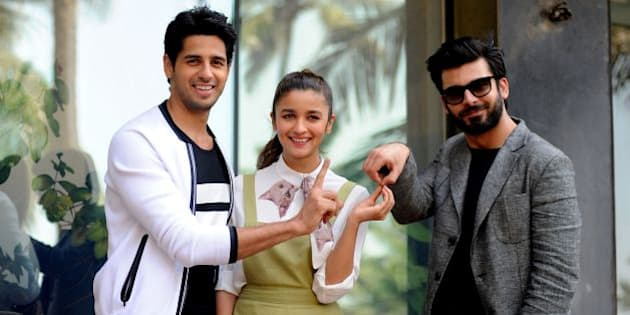Indian Bollywood actors (L-R) Sidharth Malhotra, Alia Bhatt and Fawad Khan pose during a promotional event for the upcoming Hindi film 'Kapoor & Sons' in Mumbai on March 7, 2016. / AFP / STRINGER        (Photo credit should read STRINGER/AFP/Getty Images)