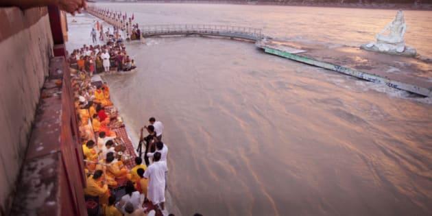 Worshippers and Yogi Sing at Sunset on Ganga The Gate At Paramartha Niketan,Rishikesh