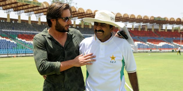 Pakistani cricket captain  Shahid Afridi shares a light moment with Pakistani Cricket Board (PCB) director Javed Miandad at The Gaddafi Stadium in Lahore on May 25, 2010. Dashing all-rounder Shahid Afridi was named Pakistan skipper for next month's Asia Cup and the following tour of England, uniting the team under one captain for all three formats of the game.  AFP PHOTO/Arif ALI (Photo credit should read Arif Ali/AFP/Getty Images)