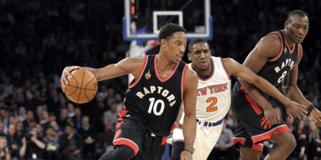 Toronto Raptors guard DeMar DeRozan (10) drives the basket as New York Knicks guard Langston Galloway (2) gets by a pick by Raptors' Bismack Biyombo during the first quarter of an NBA basketball game Monday, Feb. 22, 2016, at Madison Square Garden in New York. (AP Photo/Bill Kostroun)