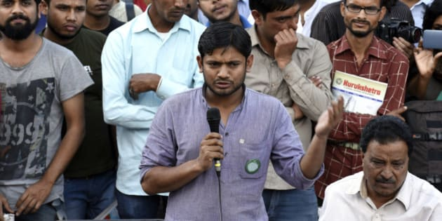 NEW DELHI, INDIA - MARCH 9: Jawaharlal Nehru University Students' Union President Kanhaiya Kumar addresses JNU teachers during the protest against the arrest of JNUSU students at JNU campus, on March 9, 2016 in New Delhi, India. JNU students' Union President Kanhaiya Kumar and two other students Umar Khalid and Anirban Bhattacharya were arrested on sedition charges for allegedly chanting anti-national slogans and favour of independence for Kashmir during an event at JNU's campus last month. (Photo by Sanjeev Verma/Hindustan Times via Getty Images)