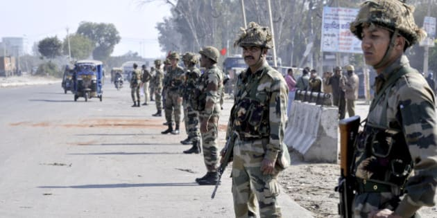PANIPAT, INDIA - FEBRUARY 22: Army jawans deployed at village Siwah after Jat agitation turned violent on February 22, 2016 in Panipat, India. Jats are agitating for quotas in jobs and want to be counted as a part of Other Backward Classes, a section that has 27% quotas in government jobs. (Photo by Parveen Kumar/Hindustan Times via Getty Images)