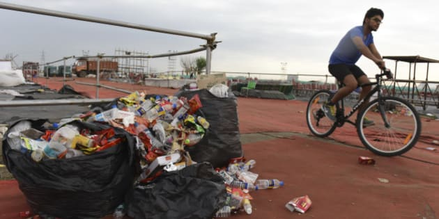 NEW DELHI, INDIA - MARCH 14: Garbage mess at the site of the Art of Living's World Culture Festival on the morning after the event, on March 14, 2016 in New Delhi, India. The three-day gala, which ended on March 13, saw a footfall of over 2 lakh visitors from scores of countries across the world. In the wake of the controversial World Culture Festival, the thousand volunteers, Sri Sri Ravi Shankar said would clean up the venue, could not be found. Instead, rag-pickers and contractors are making their way through the mess accumulated over three days of the festival. The WCF was held on Yamuna's floodplains, a fragile wetland ecology. The festival was challenged in the National Green Tribunal, which accepted that the event had damaged the floodplains, but allowed it against an initial compensation of Rs. 5 crore. (Photo by Sushil Kumar/Hindustan Times via Getty Images)