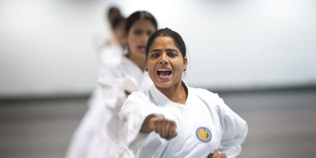 Women from the Delhi police force, undergo martial arts training at an institute in New Delhi, India, Tuesday, Nov. 25, 2014. The cadets will undergo rigorous training for up to three years and will then impart training to other policewomen who will be deployed in sensitive zones of Delhi to prevent eve teasing and other crimes against women. Tuesday marks the International Day for the Elimination of Violence against Women.(AP Photo/Saurabh Das)