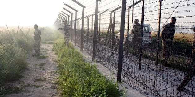 AMRITSAR, INDIA - APRIL 11: BSF troops conducting the search operation after their vehicle was attacked by Pakistani smugglers on April 11, 2015 in Amritsar, India. Three BSF jawans were injured after a cross border firing by Pakistan-based smugglers late last night near Daoke border out post (BoP) at Indo-Pak border. The BSF has recovered nearly 125 kg of heroin along the Punjab border with Pakistan this year. Nearly 65 kg was recovered in the Amritsar sector. (Photo by Sameer Sehgal/Hindustan Times via Getty Images)