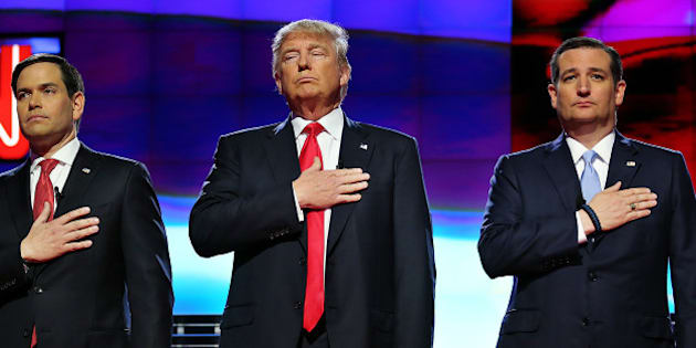 From left, Republican presidential candidates, Sen. Marco Rubio, Donald Trump, Sen. Ted Cruz, stand for the national anthem prior to the GOP presidential primary debate at the University of Miami's Bank United Center in Coral Gables, Fla., on Thursday, March 10, 2016. (Pedro Portal/El Nuevo Herald/TNS via Getty Images)