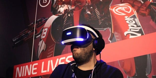 Nick Pino of TechRadar tries out a PlayStation VR video game at a Sony press event March 15, 2016 in San Francisco.