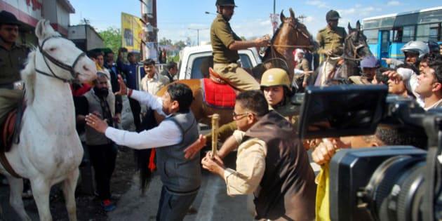 DEHRADUN, INDIA - MARCH 14: MLA Ganesh Joshi beating a horse during a BJP rally at Vidhansabha, on March 14, 2016 in Dehradun, India. (Photo by Vinay Santosh Kumar/Hindustan Times via Getty Images)