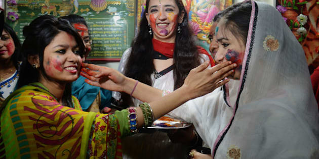 LAHORE, PUNJAB, PAKISTAN - 2015/03/05: Devotees were enjoying wiping colored powders in each other as they celebrate the Holi festival. Pakistani Hindu community gather in Krishna Temple to take a part of their religious rituals to celebrate Holi, the Spring Festival of Colors. (Photo by Rana Sajid Hussain/Pacific Press/LightRocket via Getty Images)