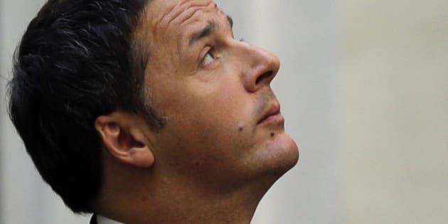 Italian Premier Matteo Renzi looks up as he waits for the arrival of Somali Prime Minister Omar Abdirashid Ali Sharmarke at Chigi palace Premier's office, in Rome, Tuesday, March 15, 2016.(AP Photo/Gregorio Borgia)